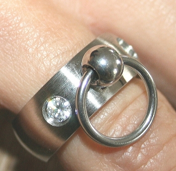 BDSM Ring of O with 2 glass crystals, clear
